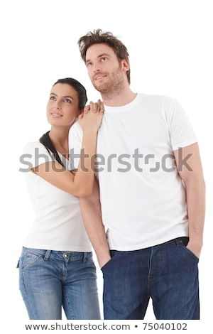 young loving couple looking up to the sky standing over white stock photo © dacasdo