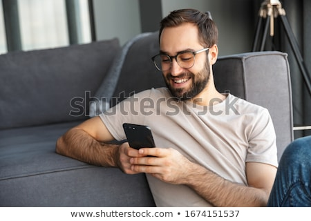Young man on couch Stock photo © photography33