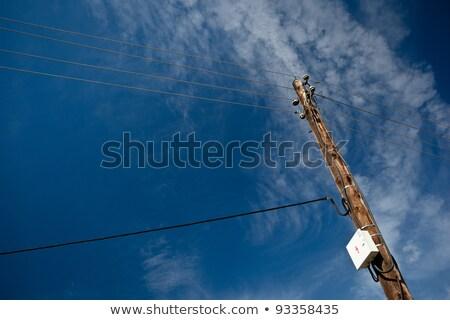telephoneelectricity pole against lovely blue sky stock photo © lightpoet