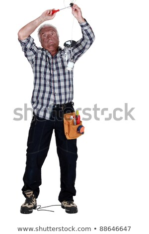 Electrocuted man fixing a light fixture Stock photo © photography33