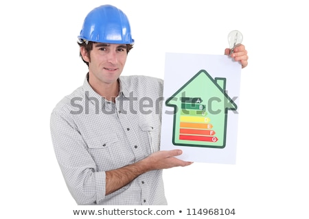 Constructor holding energy rating sign Stock photo © photography33