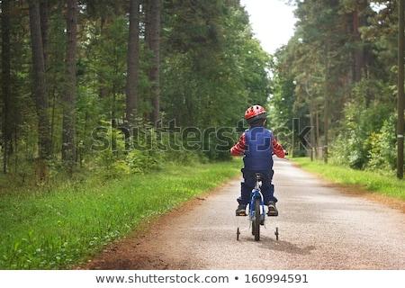 Küçük erkek binicilik bisiklet açık havada Stok fotoğraf © pekour