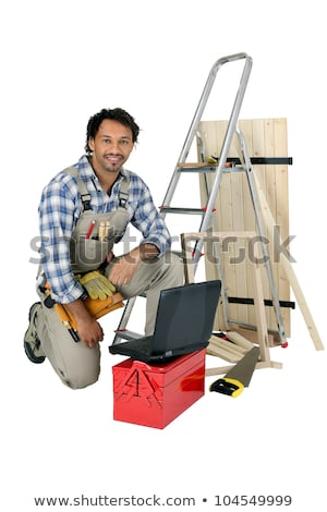 a tradesman posing with his tools building materials and his laptop stock photo © photography33