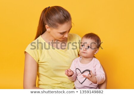 Parents with young children gaze up in amazement Stock photo © pumujcl
