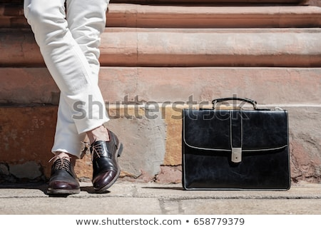 Stock photo: A man wears a new pair of shoes