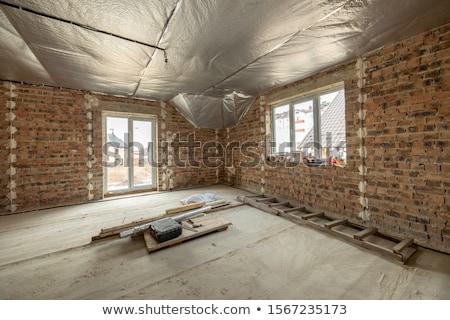 Mason working on unfinished brick wall Stock photo © photography33