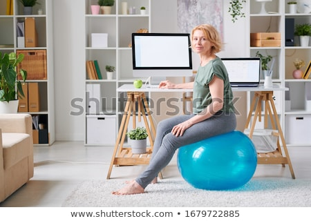 Happy ethnic woman working out with a pilates ball  stock photo © wavebreak_media