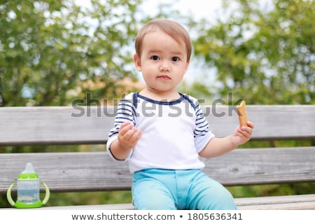 Portrait of a cute boy eating biscuits Stock photo © wavebreak_media