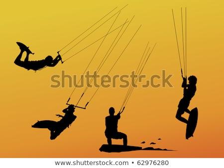 Papírsárkány szörfös sziluett ugrik repülés magas Stock fotó © acidgrey