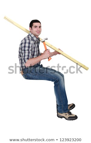 Joiner sat with plank of wood and hammer Stock photo © photography33