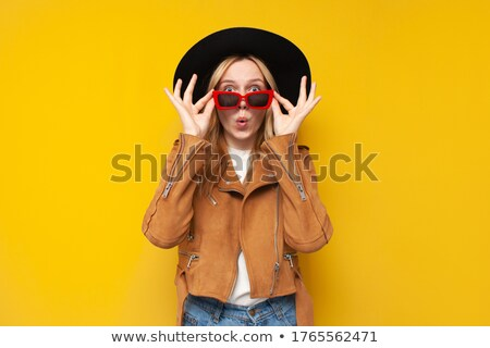 Woman with glasses taking off her hat Stock photo © photography33