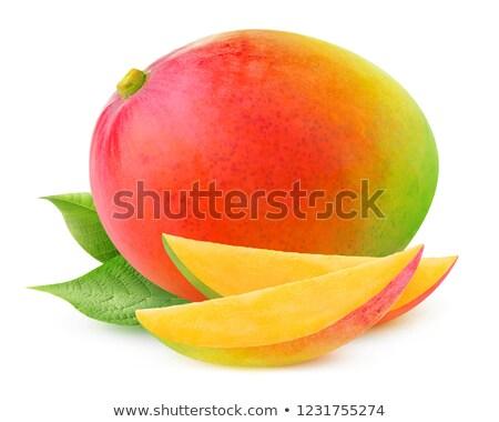 One Whole Ripe Mango And A Sliced Half Of A Mango On White