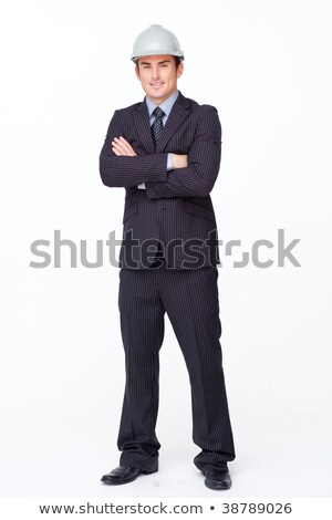 Smiling man in a suit with safety helmet and plans against white background stock photo © wavebreak_media