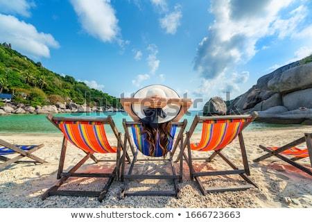 mooie · jonge · vrouw · ontspannen · zonnebank · tablet · vrouwen - stockfoto © luckyraccoon
