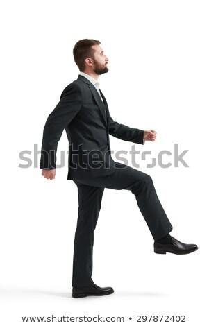 homme · d'affaires · une · jambe · jeunes · permanent · pointant - photo stock © feedough