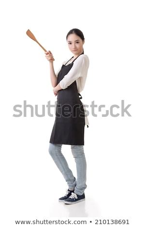 Jeune femme tablier spatule portrait blanche Photo stock © wavebreak_media
