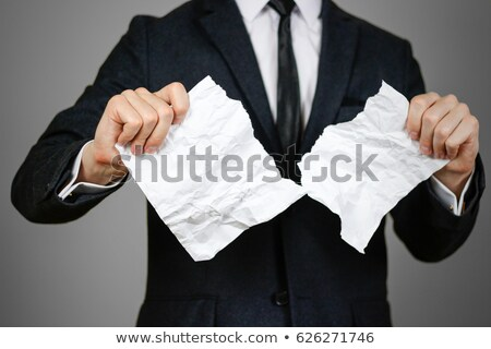 man is tearing a document paper Stock photo © dacasdo