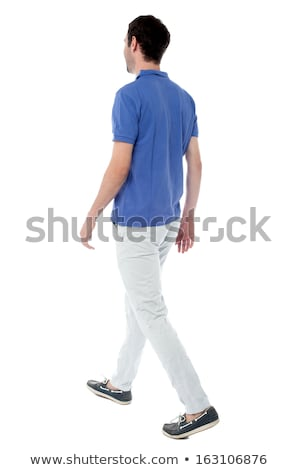 Casual young guy in walking posture Stock photo © get4net