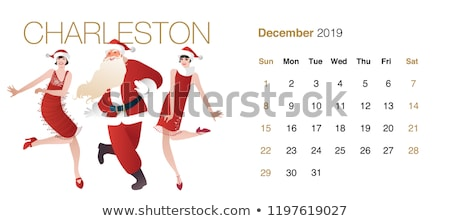 Happy young couple wearing santa claus clothes dancing Stock photo © stepstock