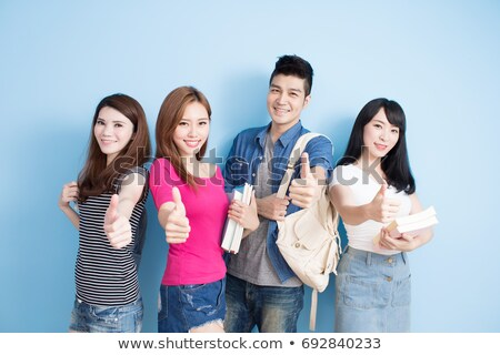 casual woman with book shows thumb up stock photo © feedough
