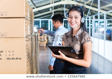 Customer Service in Asian logistics warehouse Stock photo © Kzenon