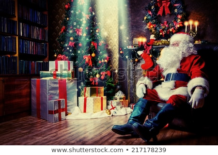 portrait of kind santa claus with christmas present stock photo © hasloo