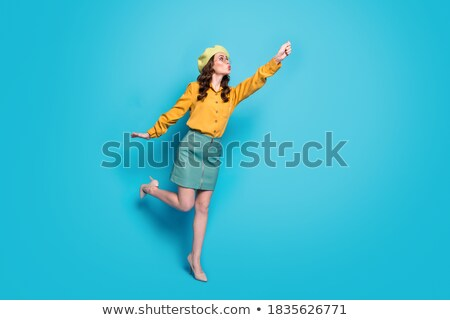 Woman try hold hat and umbrella Stock photo © vetdoctor