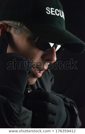Security Guard Reports Into Microphone Stock photo © jackethead