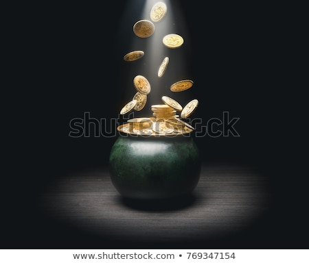 Stock photo: gold coins falling in the vintage pot