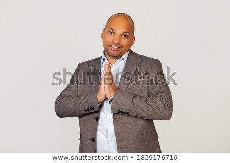 businessman standing with hands clasped in front of him Stock photo © dgilder