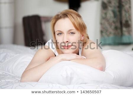 Seductive Pretty Blond Woman Lying in Bed Stock photo © stryjek