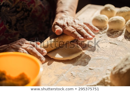 bowl with flour and old rolling pin stock photo © zerbor