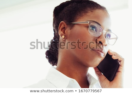 portrait of a young pensive woman talking on the phone stock photo © deandrobot