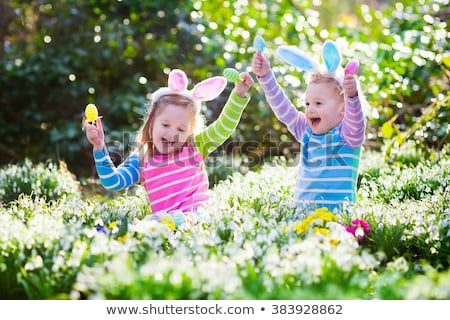 Baby girl playing with easter eggs stock photo © nyul