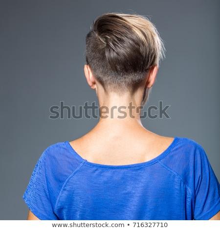 Portrait of a blond lady with a trendy fringe Stock photo © konradbak