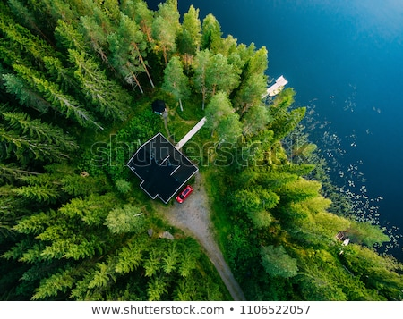 idylic wooden cottage on a lake stock photo © tommyandone