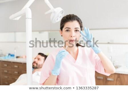 portré · női · sebész · mutat · sebészi · kesztyű - stock fotó © master1305