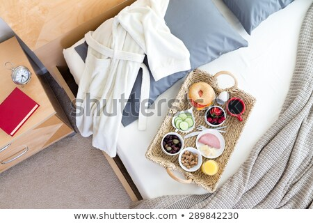 bathrobe and breakfast tray on unmade bed stock photo © ozgur
