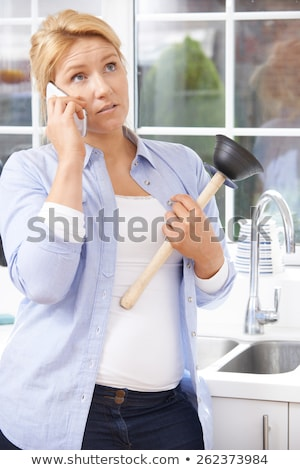 frustrated woman calling plumber to fix blocked sink at home stock photo © highwaystarz