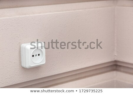 white electric socket on the wall close up stock photo © inxti