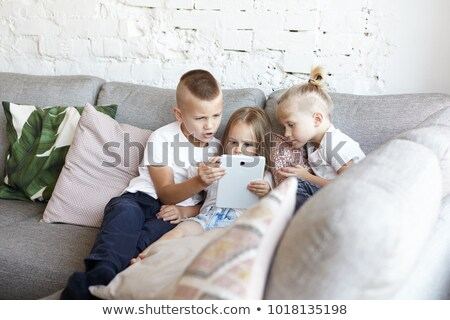 girl and her little brother arguing with a digital tablet comput Stock photo © vladacanon