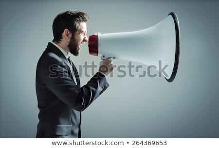 business man screaming on megaphone at boss stock photo © fuzzbones0
