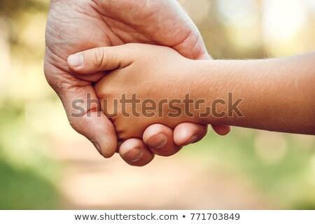 grand-père · petit-enfant · mains · ciel · sourire · visage - photo stock © Paha_L