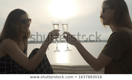 Lesbiennes couple champagne verres personnes Photo stock © dolgachov