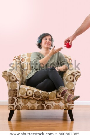 Dissatisfied woman given a cup Stock photo © ozgur