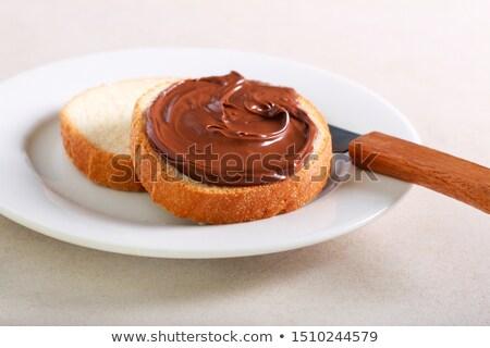 Hazelnut nougat cream spread over bread slice Stock photo © stevanovicigor