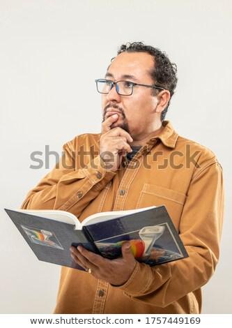 парень · книга · голову · мышления · серый · лице - Сток-фото © Patramansky