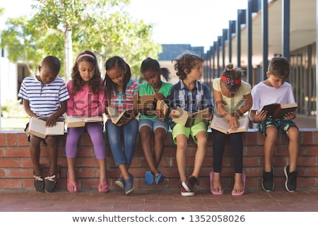 Сток-фото: группа · детей · чтение · книгах · дети · изучения