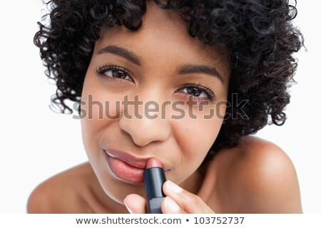 Pretty smiling young woman using lipstick on half of lips Stock photo © deandrobot