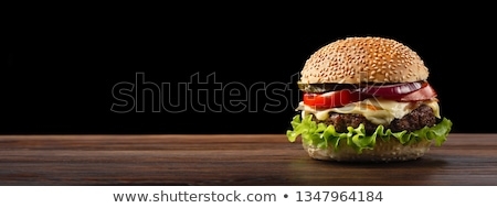 black bun for the burger close up on paper on a dark background stock photo © mcherevan